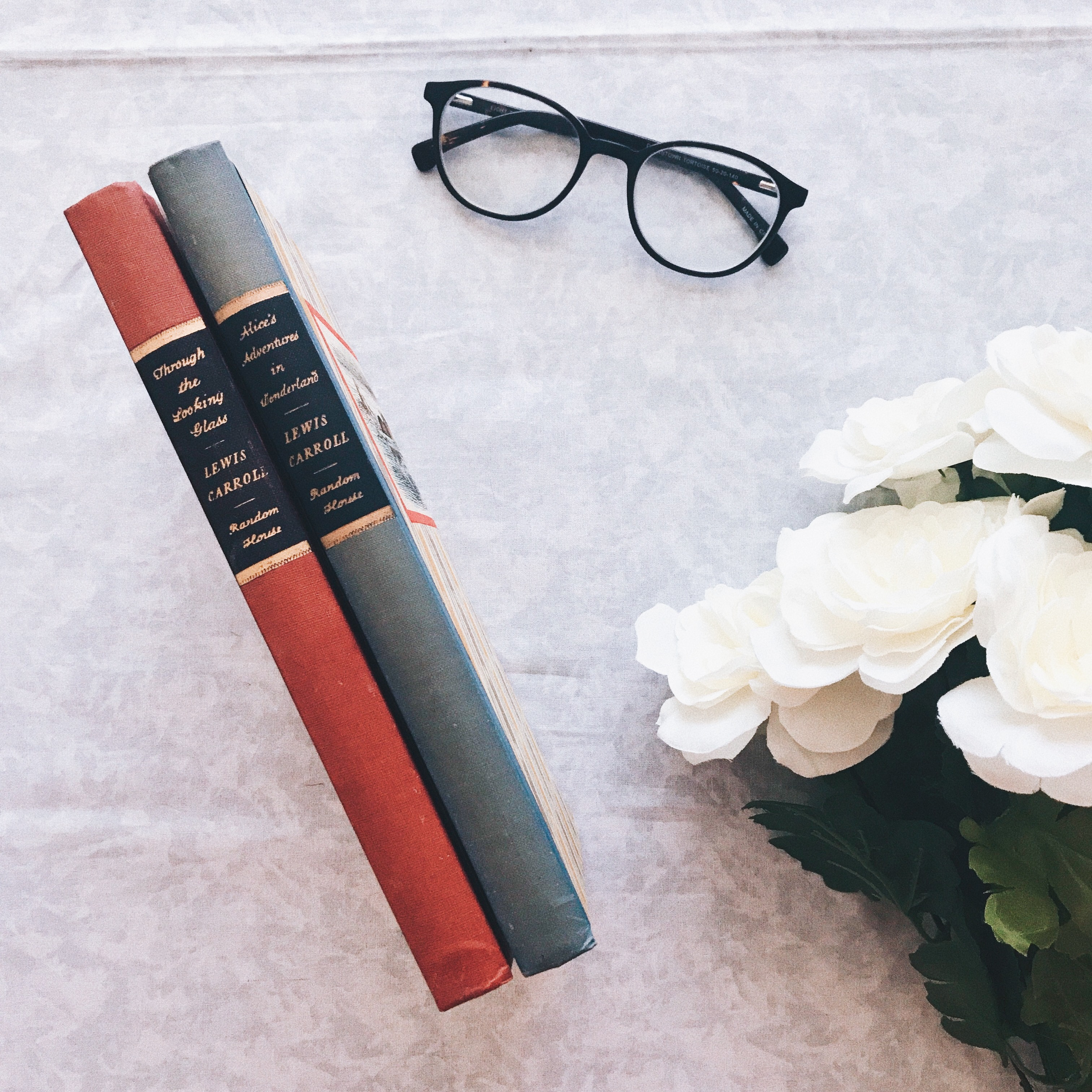 glasses with books and flowers in september