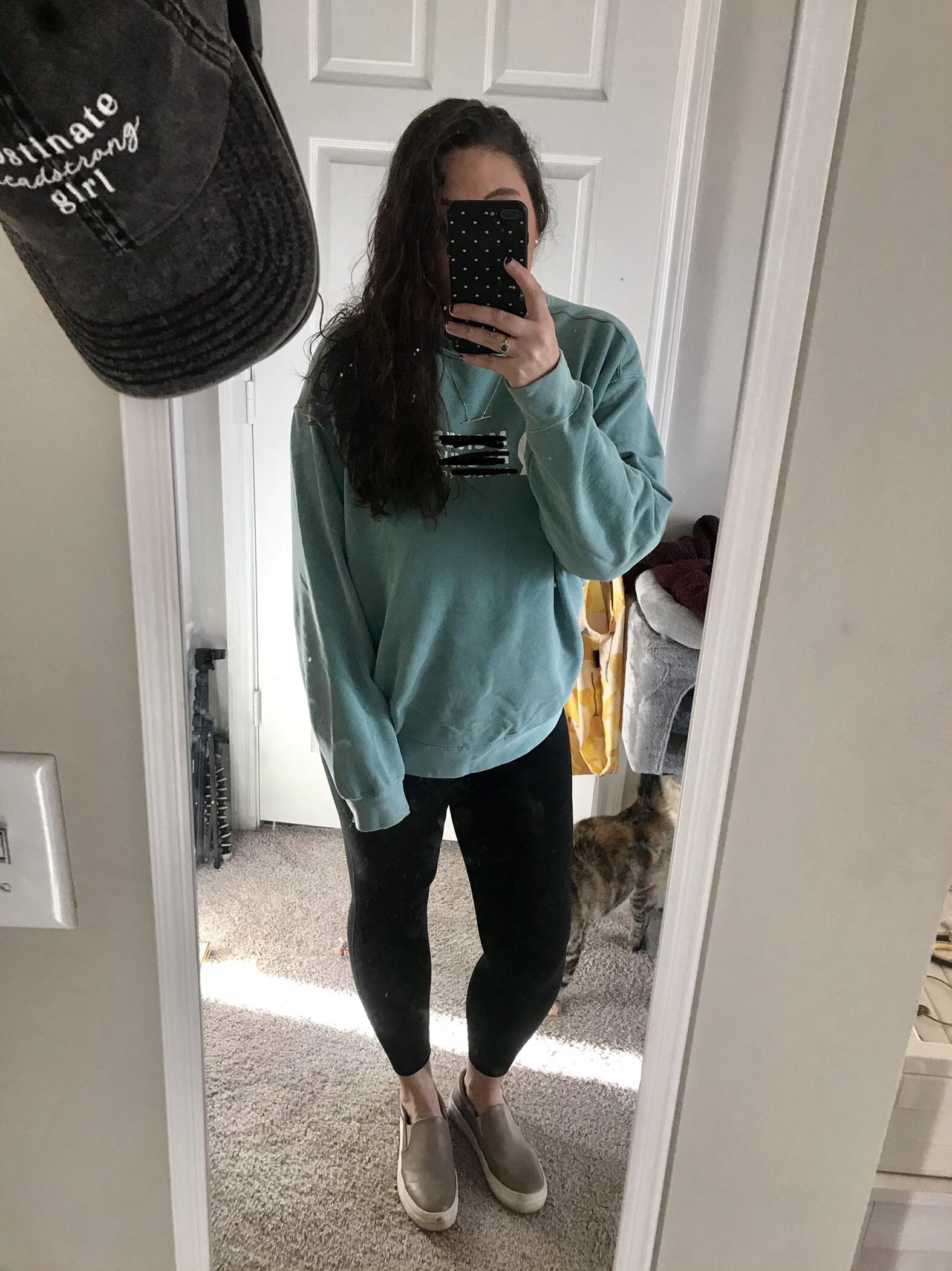 Girl in teal sweatshirt with black leggings