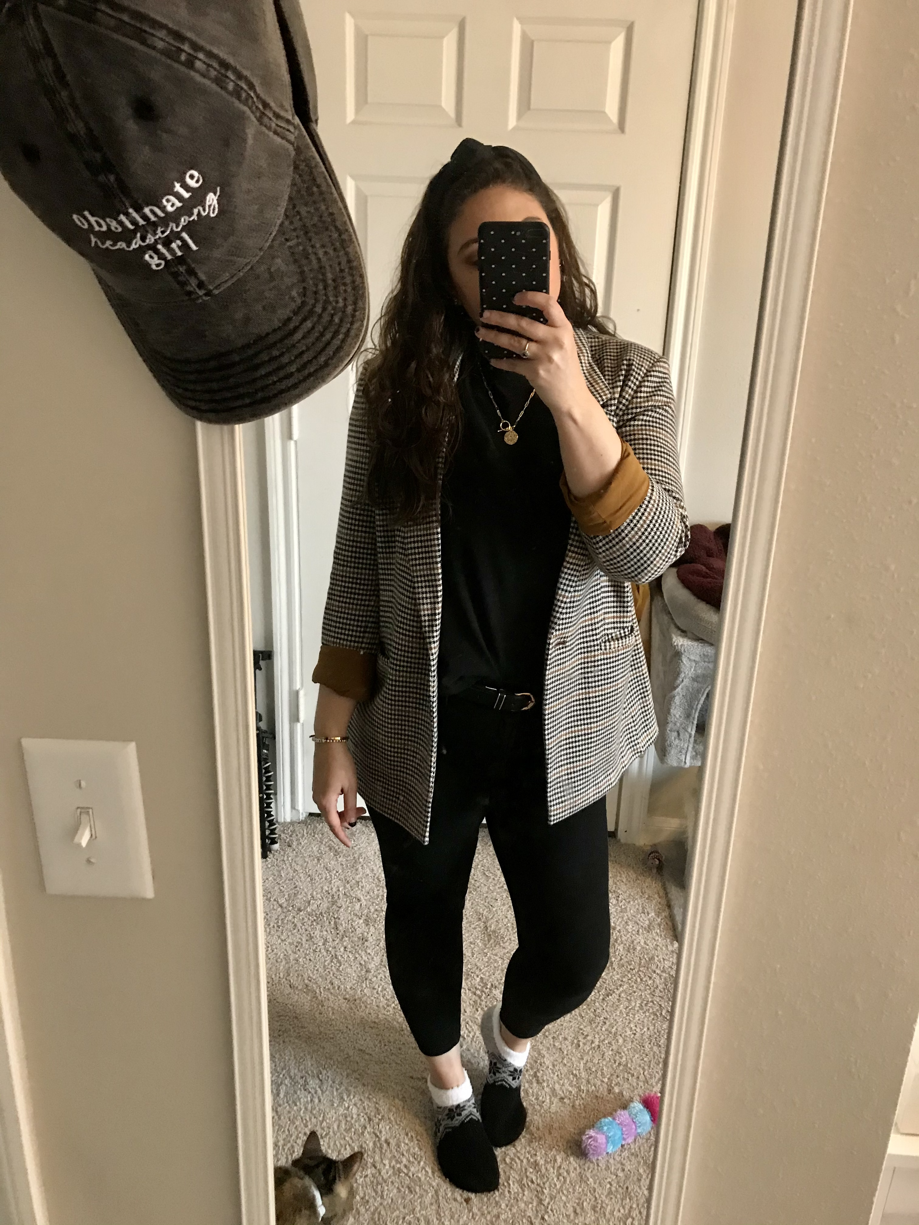 girl in black t-shirt, plaid blazer and jeans