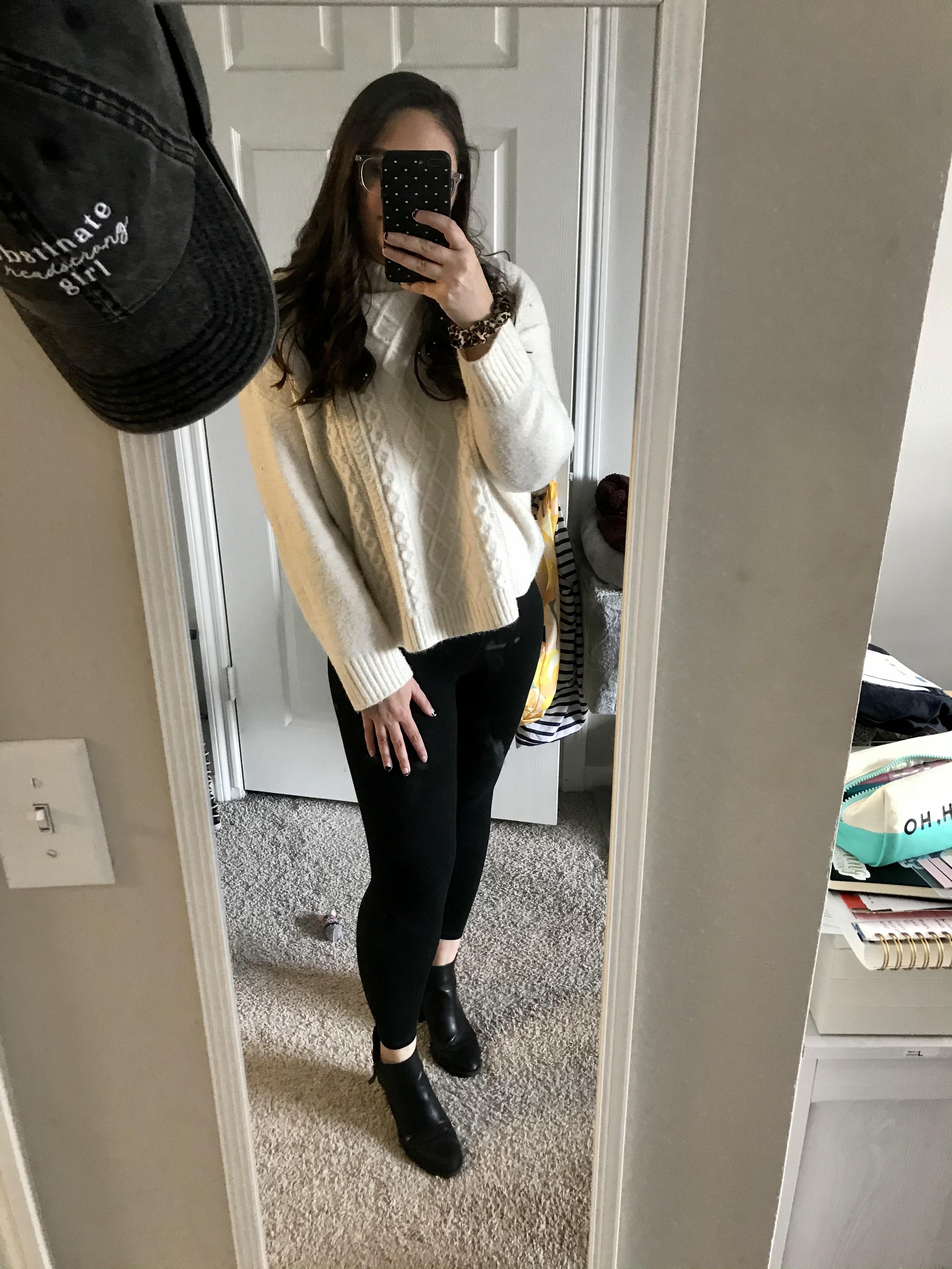 girl in white sweater and black leggings
