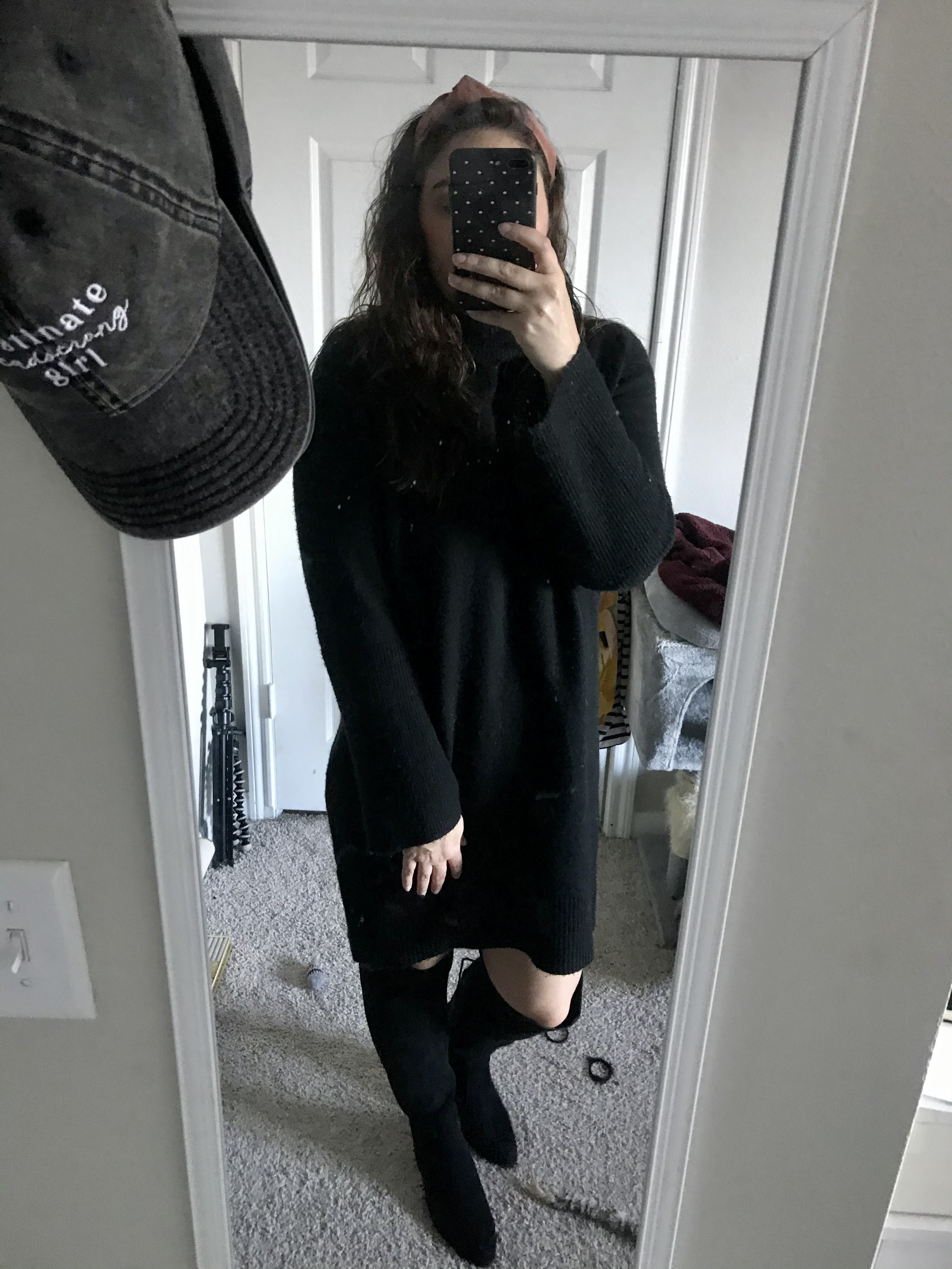 girl in black sweaterdress and knee high black boots