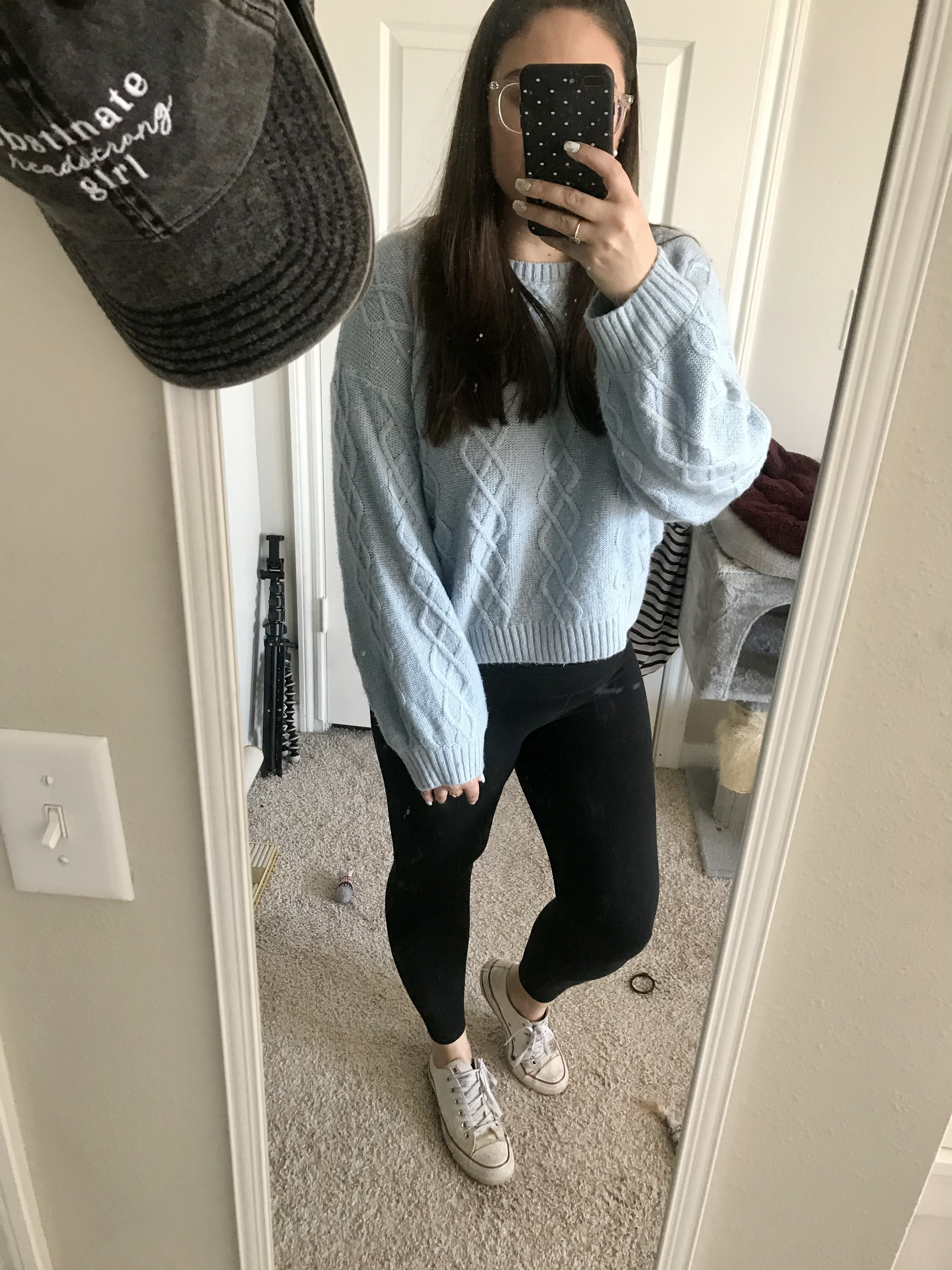 girl in blue sweater and black jeans and converse