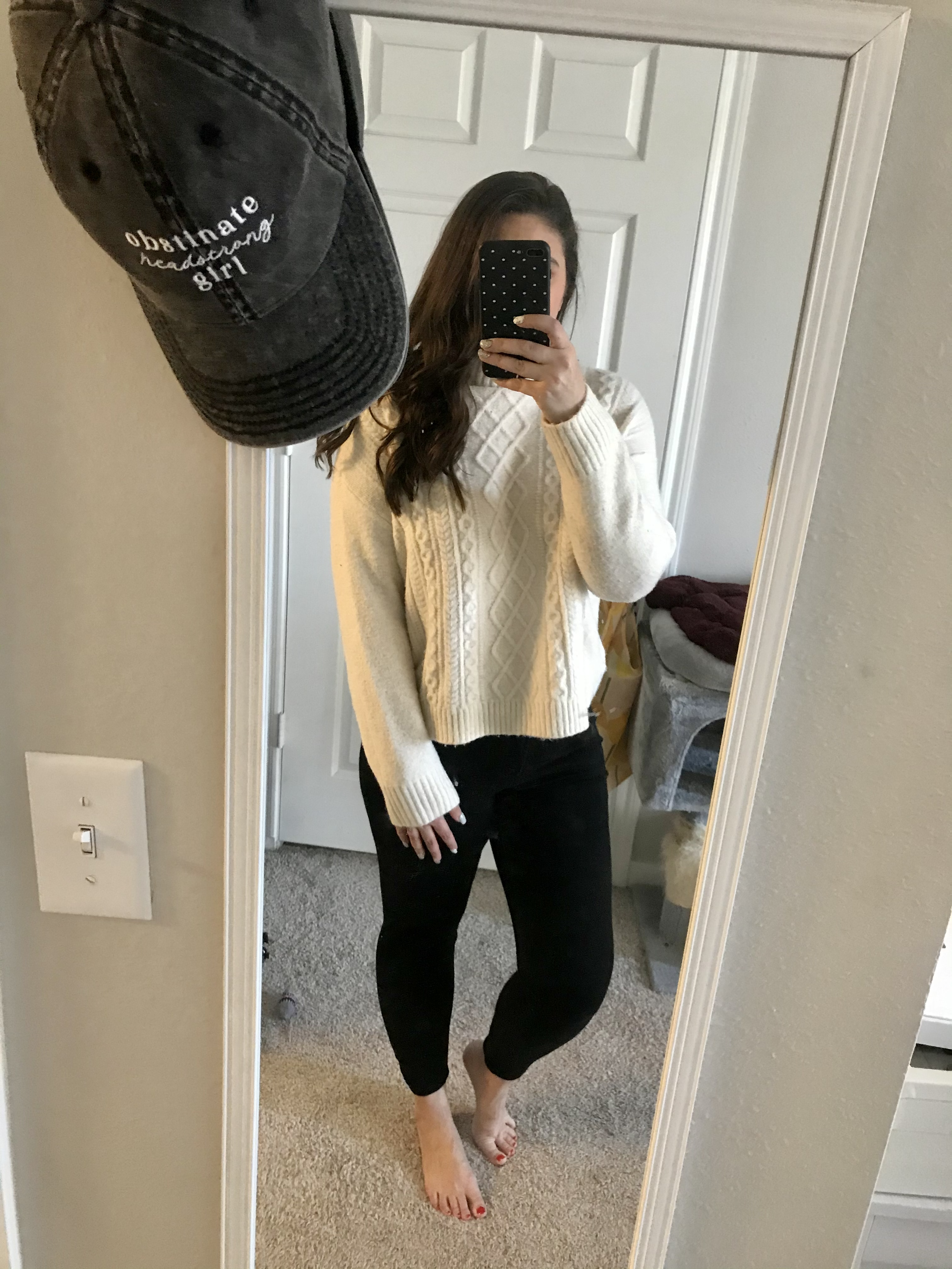 girl in white sweater and black jeans