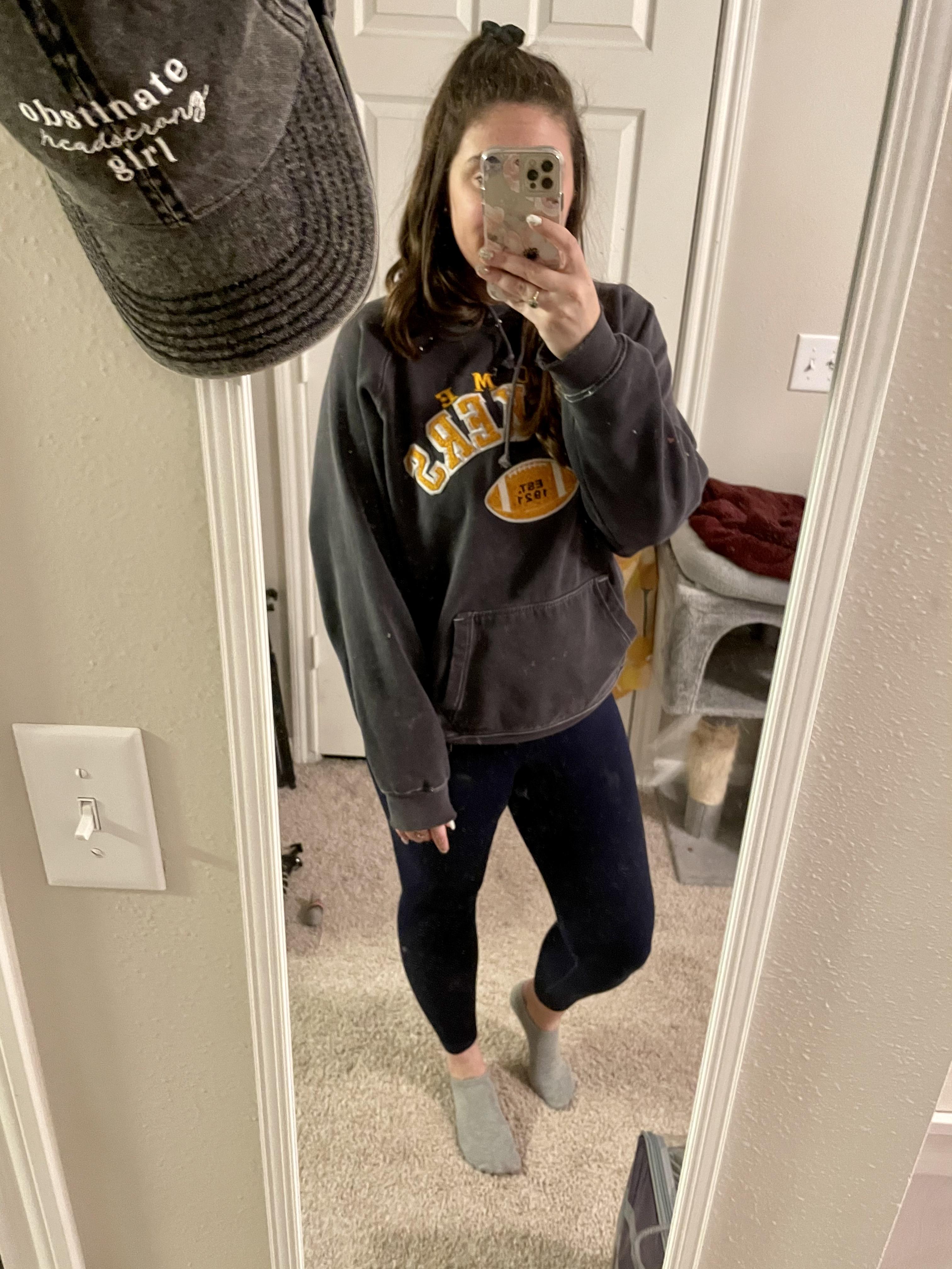 girl in packers sweatshirt and leggings