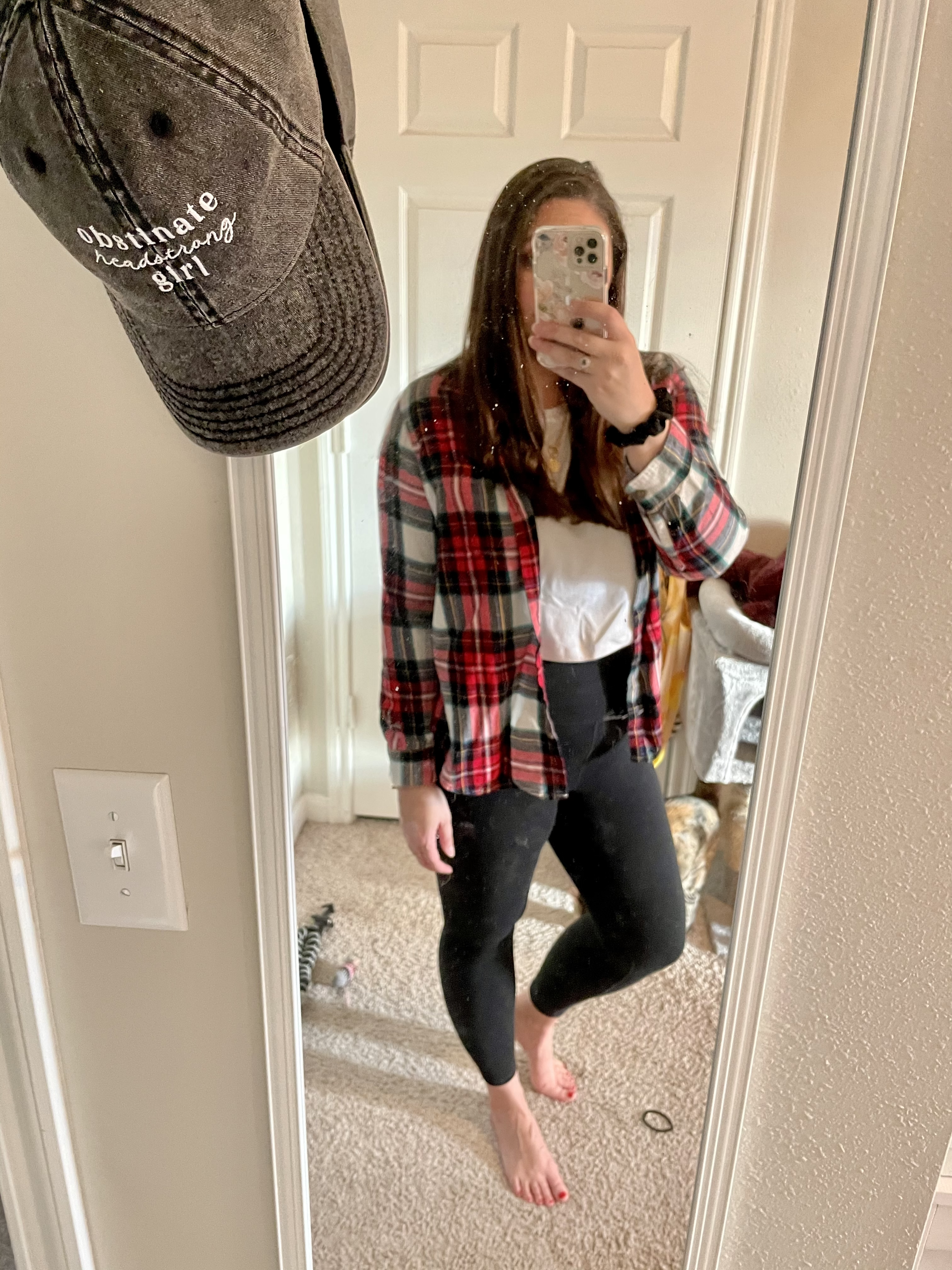 girl in plaid shirt, white top and leggings
